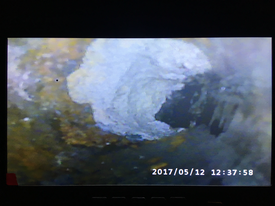Camera inspection reveals grease buildup easily removed with a high pressure jetting from Econo Drain